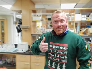 Lab member posing in Science sweater