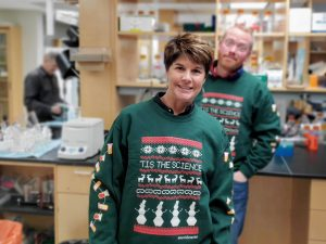 Lab members posing in Science sweater